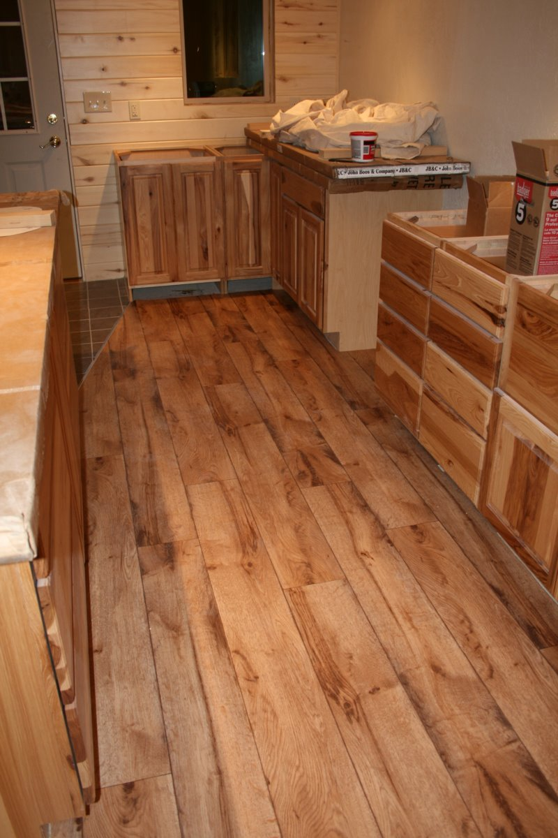 Vinyl floors are installed in kitchen laundry room and for Wood linoleum